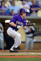 LSU Tigers outfielder Sean McMullen #7 prepares to run to first base during the Southeastern Conference baseball game against the Georgia Bulldogs on March 22, 2014 at Alex Box Stadium in Baton Rouge, La. The Tigers defeated the Bulldogs 2-1. (Andrew Woolley/Four Seam Images)