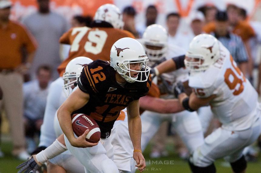 01 APRIL 2006: University of Texas freshman quarterback hopeful, Colt McCoy, runs the ball at Darrell K. Royal Memorial Stadium during the Longhorns annual spring Orange vs White Scrimmage.