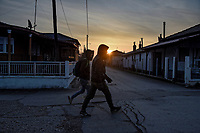 Pictured: Two migrants walk in the streets of Nea Vyssa near the Greek-Turkish border. Sunday 01 March 2020<br /> Re: Clashes between migrants and riot police at the Greek-Turkish border of Kastanies near Evros, Greece
