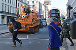 Pictured:  Pedestrians look on as James Haskell rides ontop of the Grenade® tank around Central London in protest of #KeepingGymsOpen during the second Coronavirus lockdown that starts tomorrow in England.<br /> <br /> A bright orange tank driven by England rugby star James Haskell headed to Parliament Square today and caused a ruckus as it was stopped by police.  The former international was joining performance nutrition brand Grenade in protesting gyms and leisure centres being classified as 'non-essential' under new lockdown regulations.<br /> <br /> There were a reported 22 million visits to gyms after they reopened in July, with just 78 Covid cases being tracked to these locations.  With England set to return to a nationwide lockdown from tomorrow (Thursday November 4) these leisure facilities will once again be forced to close, not being classed as 'essential'. SEE OUR COPY FOR DETAILS<br /> <br /> © Solent News & Photo Agency<br /> UK +44 (0) 2380 458800