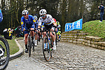 The peloton including World Champion Julian Alaphilipe (FRA) and Yves Lampaert (BEL) Deceuninck-Quick Step summit the Muur van Geraardsbergen during the 76th edition of Omloop Het Nieuwsblad 2021 running 200km from Gent to Ninove, Belgium. 27th February 2021  <br /> Picture: Serge Waldbillig | Cyclefile<br /> <br /> All photos usage must carry mandatory copyright credit (© Cyclefile | Serge Waldbillig)