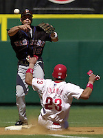 New York Mets second baseman Roberto Alomar (12) makes the force out on a sliding Philadelphia Phillies Placido Polanco (23) but his throw is late to first allowing Phillies Marlon Anderson a hit in the 2nd inning of play Saturday Sept. 7, 2002 in Philadelphia. (AP Photo/Brad C Bower)