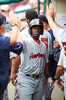 Pawtucket Red Sox outfielder Rusney Castillo (31) high fives teammates in the dugout after scoring a run during a game against the Rochester Red Wings on July 1, 2015 at Frontier Field in Rochester, New York.  Rochester defeated Pawtucket 8-4.  (Mike Janes/Four Seam Images)