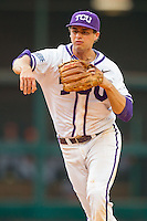 Texas Christian Horned Frogs second baseman Connor Castellano #4 makes a throw to first base against the Sam Houston State Bearkats at Minute Maid Park on February 28, 2014 in Houston, Texas.  The Bearkats defeated the Horned Frogs 9-4.  (Brian Westerholt/Four Seam Images)