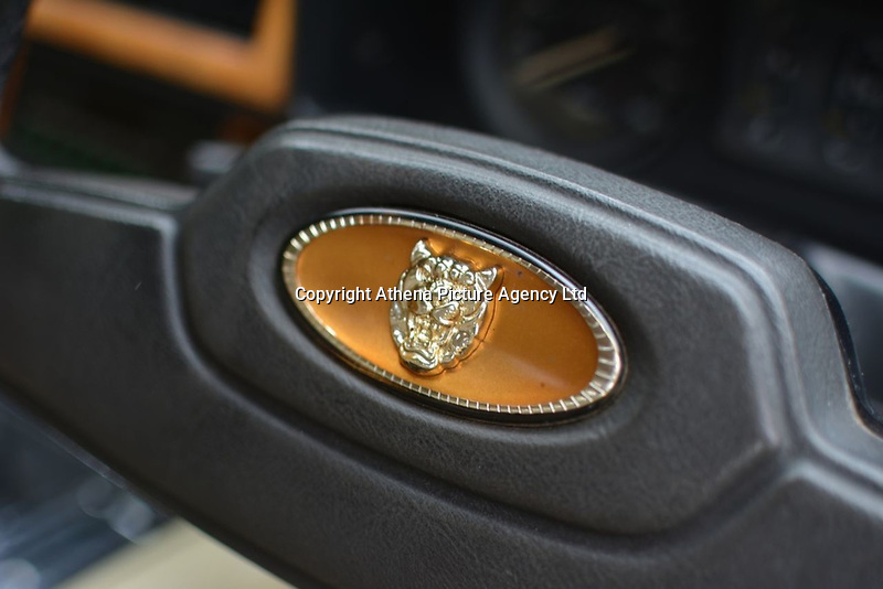 """Pictured: The emblem on the steering wheel of the Jaguar up for auction, once owned by Eamonn Holmes<br /> Re: A luxury open-top car sold by TV's Eamonn Holmes to pay off his """"massive"""" tax bill is up for grabs at auction.<br /> The host of Good Morning Britain bought the 5.3 litre Jaguar when he was earning big bucks with the BBC.<br /> But Eamonn was made redundant and at the same time he was hit with an £11,000 demand from the Inland Revenue.<br /> The car was costing him a fortune to run - it did under 15mpg.<br /> After paying a whopping £36,000 for the Jaguar XJSC, Eamonn flogged it for just £8,000 a year later.<br /> The car has an identical price tag at auction almost 30 years later.    <br /> Eamonn, 57, told how he got shot of the Jag when the 1990 Gulf War sparked a big hike in fuel prices.<br /> He said: """"Cars are my weakness - in 1989 I bought a British Racing Green Jaguar.<br /> """"I paid £36,000 in March 1989 then in early 1990 the Gulf War broke out."""