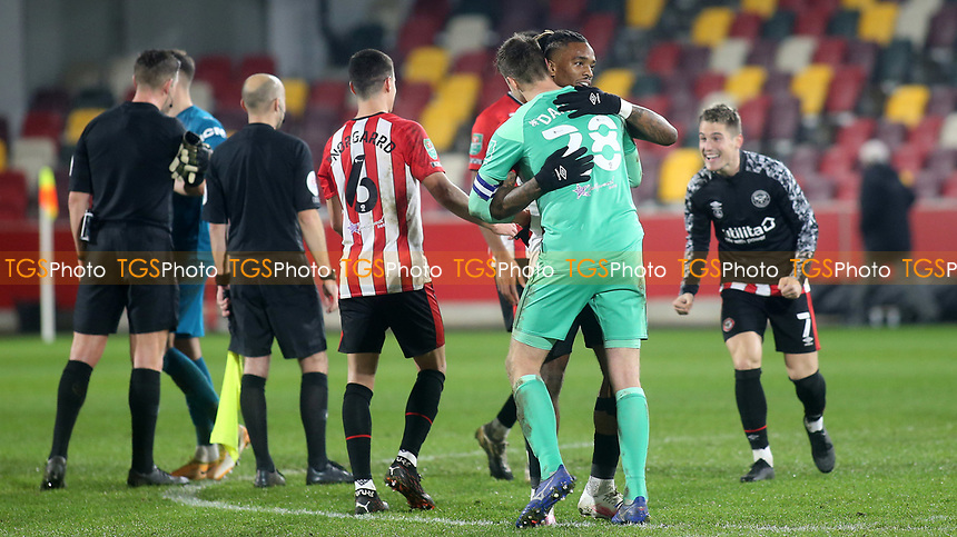 Brentford's Ivan Toney and goalkeeper, Luke Daniels, celebrate their victory at the final whistle during Brentford vs Newcastle United, Carabao Cup Football at the Brentford Community Stadium on 22nd December 2020