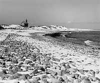 Snow coats the sand dunes at North Light on Block Island