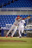Clearwater Threshers first baseman Damek Tomscha (21) stretches for a throw as D.J. Davis (6) runs through the bag during a game against the Dunedin Blue Jays on April 8, 2017 at Florida Auto Exchange Stadium in Dunedin, Florida.  Dunedin defeated Clearwater 12-6.  (Mike Janes/Four Seam Images)