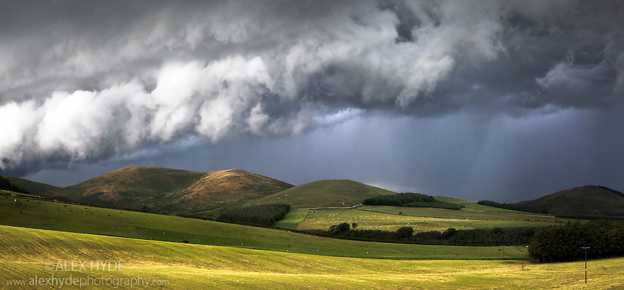 Storm clouds breaking over the Cheviot Hills, Northumberland National Park, UK.