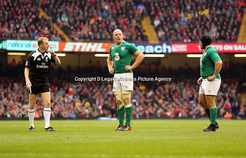 Pictured: Paul O'Connell of Ireland (C) is spoken to by referee Wayne Barnes (L) Saturday 14 March 2015<br /> Re: RBS Six Nations, Wales v Ireland at the Millennium Stadium, Cardiff, south Wales, UK.