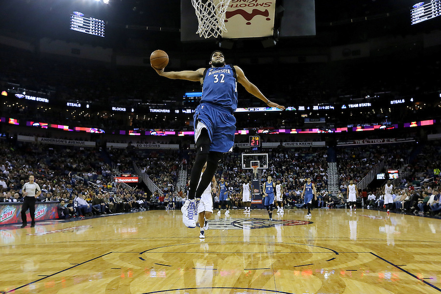 Minnesota Timberwolves center Karl-Anthony Towns (32) dunks the ball during the second half of an NBA basketball game Saturday, Feb. 27, 2016, in New Orleans. The Timberwolves won 112-110. (AP Photo/Jonathan Bachman)