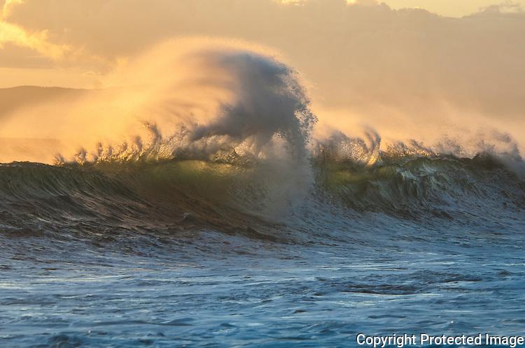 Strong wind pushing against the waves, at makena beach, Maui Hawaii.
