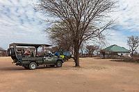 Tanzania.  Game Drive Vehicle Waiting at Lobo Airstrip, Serengeti National Park.  Waiting Room on right.
