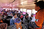 (at right) A member of Grupo Beta, Mexico's Search and Rescue agency, talks to a bus filled with Mexican and Central Americans, bound for the border with Arizona. The Grupo Beta officer reminded them of the dangers of crossing the border, the low temperatures at night, and the real possibility of loosing their lives, as thugs and the organized crime who operate in these areas, add to the mix of dangers associated with illegal immigration. .Sasabe, Sonora-Mexico. 01/22/05