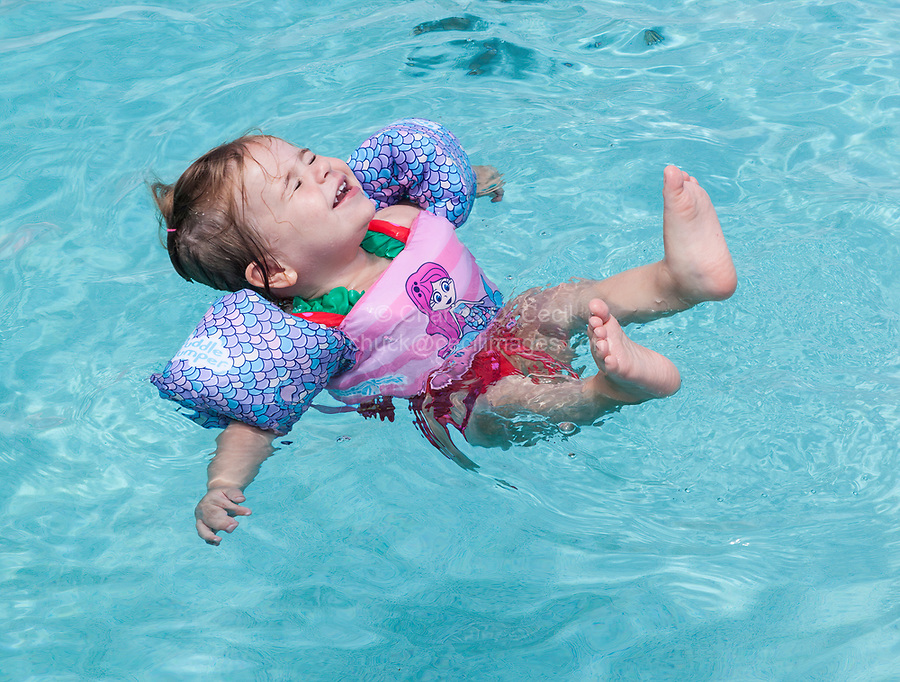 Avon, Outer Banks, North Carolina.  Two-year-old with Water Wings in Swimming Pool. (Model Released)
