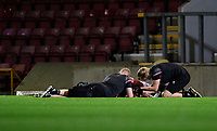 Lincoln City's Max Melbourne receives treatment for an injury from Lincoln City sports science and medicine assistant Luke Treadwell, left, and Lincoln City's head of sports science and medicine Mike Hine<br /> <br /> Photographer Chris Vaughan/CameraSport<br /> <br /> Carabao Cup Second Round Northern Section - Bradford City v Lincoln City - Tuesday 15th September 2020 - Valley Parade - Bradford<br />  <br /> World Copyright © 2020 CameraSport. All rights reserved. 43 Linden Ave. Countesthorpe. Leicester. England. LE8 5PG - Tel: +44 (0) 116 277 4147 - admin@camerasport.com - www.camerasport.com