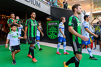 AUSTIN, TX - JUNE 19: Cecilia Dominguez #10 of the Austin FC and son enter the pitch before a game between San Jose Earthquakes and Austin FC at Q2 Stadium on June 19, 2021 in Austin, Texas.