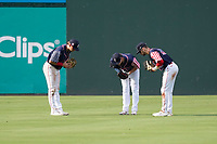 Outfielders Tyler Dearden, Tyler Esplin and Wil Dalton of the Greenville Drive celebrate the final out of a win in a game against the Aberdeen IronBirds on Sunday, July 11, 2021, at Fluor Field at the West End in Greenville, South Carolina. (Tom Priddy/Four Seam Images)