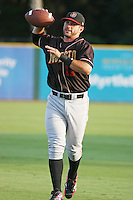 Modesto Nuts infielder James Cesario of the California League All- Stars throwing a football in the outfield before the California League vs. Carolina League All-Star game held at BB&T Coastal Field in Myrtle Beach, SC on June 22, 2010.  The California League All-Stars defeated the Carolina League All-Stars by the score of 4-3.  Photo By Robert Gurganus/Four Seam Images