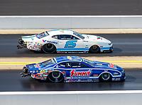 Sep 17, 2017; Concord, NC, USA; NHRA pro stock driver Tanner Gray (far) races alongside Jason Line during the Carolina Nationals at zMax Dragway. Mandatory Credit: Mark J. Rebilas-USA TODAY Sports