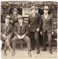 BNPS.co.uk (01202 558833)<br /> Pic: SheldonCarpenter/Witherell'sInc/BNPS<br /> <br /> Pictured: Vintage silver print photograph of Al Capone (third from left) and his associates at Hot Springs, Arkansas.<br /> <br /> An incredible treasure trove of Al Capone heirlooms have sold at auction for a whopping £2.3m. ($3.1m)<br /> <br /> The star lot was the notorious American gangster's favourite gun - a 1911 Colt semi-automatic pistol, which was expected to fetch £110,000 but sold for an incredible £764,000. ($1.04m)<br /> <br /> The remarkable collection, sold by his granddaughters, included personalised jewellery, photographs and furniture and a letter written to his only child Sonny from Alcatraz Prison, which showed a tender side to the ruthless crime boss.