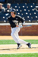 Garrett Kelly (28) of the Wake Forest Demon Deacons follows through on his swing against the Youngstown State Penguins at Wake Forest Baseball Park on February 24, 2013 in Winston-Salem, North Carolina.  The Demon Deacons defeated the Penguins 6-5.  (Brian Westerholt/Four Seam Images)