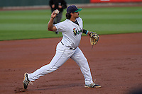Cedar Rapids Kernels third baseman T.J. White (16) throws to first between innings during game five of the Midwest League Championship Series against the West Michigan Whitecaps on September 21st, 2015 at Perfect Game Field at Veterans Memorial Stadium in Cedar Rapids, Iowa.  West Michigan defeated Cedar Rapids 3-2 to win the Midwest League Championship. (Brad Krause/Four Seam Images)
