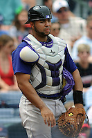 Colorado Rockies catcher Wilin Rosarion #20 during a game against the Atlanta Braves at Turner Field on September 3, 2012 in Atlanta, Georgia. The Braves  defeated the Rockies 6-1. (Tony Farlow/Four Seam Images).
