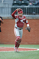Arkansas Razorbacks catcher Grant Koch (33) jogs off the field between innings of the game against the Charlotte 49ers at Hayes Stadium on March 21, 2018 in Charlotte, North Carolina.  The 49ers defeated the Razorbacks 6-3.  (Brian Westerholt/Four Seam Images)