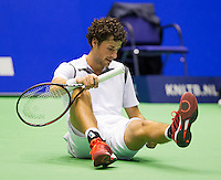 Rotterdam, Netherlands, December 18, 2015,  Topsport Centrum, Lotto NK Tennis, Robin Haase (NED) slips and falls on the court<br /> Photo: Tennisimages/Henk Koster