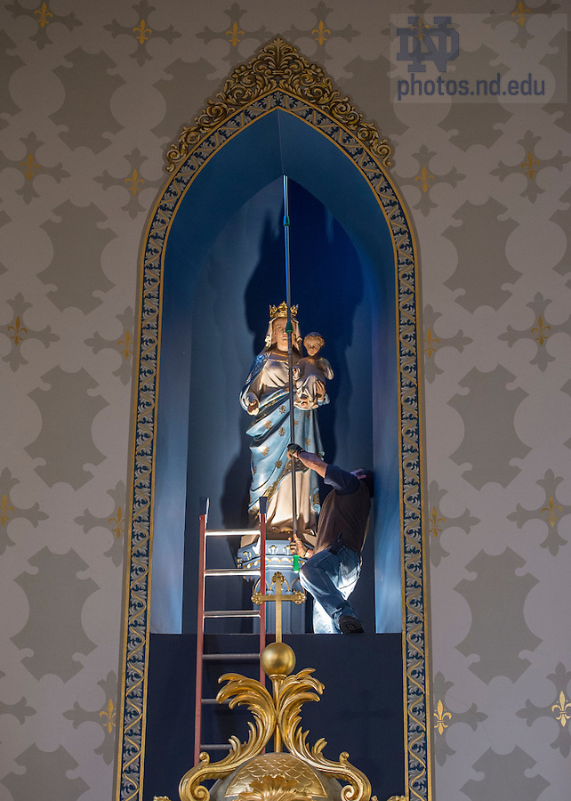 Mar. 2, 2015; A worker changes a light fixture in the Lady Chapel of the Sacred Heart Basilica in preparation for the wake and funeral services for President Emeritus Rev. Theodore M. Hesburgh, C.S.C.. (Photo by Barbara Johnston/University Photographer)