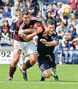 Rovers' player / manager Grant Murray grapples with Hearts' John Stutton