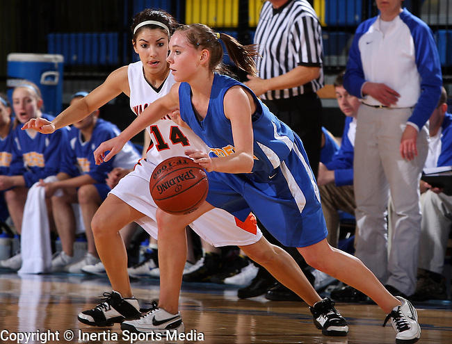 BROOKINGS, SD - March 12, 2009 : Megan Jordre of Aberdeen Central dribbles around the perimeter while under pressure from Logan Lower #14 of Sioux Falls Washington in their State Girls AA Tournament game at Frost Arena in Brookings. (Photo By Stephen Brua/ Inertia)