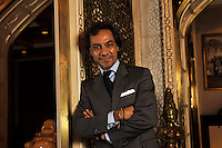 Dr Aron Harilela, 37, director of The Harilela Group and next in line to take the throne of the prominent family's business empire, in the Mogal room of their Kowloon Tong residence in Hong Kong 18th October 2009.<br /> <br /> Photo by Richard Jones