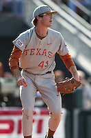 Texas Longhorns pitcher John Curtiss (43) watches his infield make a play during the NCAA baseball game against the Houston Cougars on June 6, 2014 at UFCU Disch–Falk Field in Austin, Texas. The Longhorns defeated the Cougars 4-2 in Game 1 of the NCAA Super Regional. (Andrew Woolley/Four Seam Images)