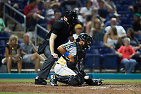 Kannapolis Cannon Ballers catcher Kleyder Sanchez (12) blocks a low pitch as home plate umpire Jacob McConnell looks on during the game against the Lynchburg Hillcats at Atrium Health Ballpark on August 28, 2021 in Kannapolis, North Carolina. (Brian Westerholt/Four Seam Images)