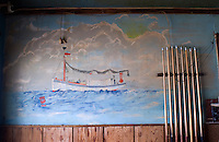 A nautical mural on the wall of a billiard hall that is being converted to a Mexican restaurant near Golden Meadow, Louisiana. Fishing and a relationship to the sea are essential to the identity of many residents of coastal Louisiana, even as the fishing industry suffers.