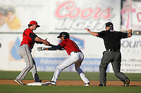 May 2, 2010: Jay Austin of the Lancaster JetHawks steals second base ahead of the tag by Drew Cumberland of the Lake Elsinore Storm at Clear Channel Stadium in Lancaster,CA.  Photo by Larry Goren/Four Seam Images