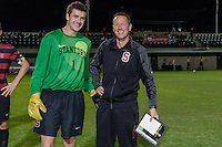 November 13, 2013: Drew Hutchins and Head Coach Jeremy Gunn during the senior day ceremony before the Stanford vs Cal men's soccer match in Stanford, California.  Stanford won 2-1 in overtime.