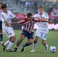 Chivas USA forward Juan Pablo Garcia  dribbles past D.C. United forward Alecko Eskandarian and midfielder Brian Carroll.  D.C. United defeated Chivas USA, 2-1, at the Home Depot Center in Carson, Calif. on September 3, 2006.