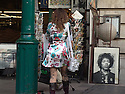 Jimi Hendrix portrait looks out with easy majesty, with help from the funky time-traveling lady, Covent Garden, 2007.