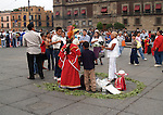 Crowd gathers around shaman in zocalo in Mexico City D.F.