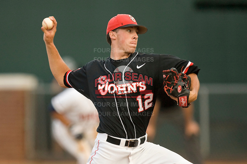 Relief pitcher Eddie Medina #12 of the St. John's Red Storm in action against the Virginia Cavaliers in the championship game of the Charlottesville Regional at Davenport Field on June 7, 2010, in Charlottesville, Virginia.  The Cavaliers defeated the Red Storm 5-3.  Photo by Brian Westerholt / Four Seam Images