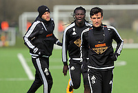 L-R Gylfi Sigurdsson, Bafetimbi Gomis and Jack Cork during the Swansea City FC training at Fairwood training ground in Wales, UK on Wednesday 06 April 2016