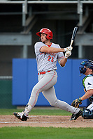 Greeneville Reds left fielder Brandt Stallings (25) follows through on a swing during the second game of a doubleheader against the Princeton Rays on July 25, 2018 at Hunnicutt Field in Princeton, West Virginia.  Greeneville defeated Princeton 8-7.  (Mike Janes/Four Seam Images)