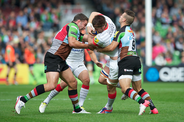 Ernst Joubert of Saracens is tackled by Nick Easter (left) and Danny Care of Harlequins during the Aviva Premiership match between Harlequins and Saracens at the Twickenham Stoop on Sunday 30th September 2012 (Photo by Rob Munro)