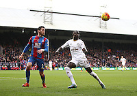 Joel Ward of Crystal Palace and Modou Barrow of Swansea   during the Barclays Premier League match between Crystal Palace and Swansea  played at Selhurst Park on 28th December 2015 in London