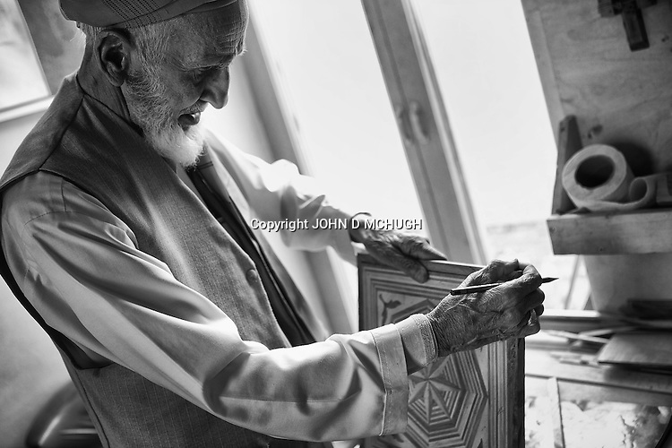 Abdulhadi, 83, a carving instructor, works on a piece at The Turquoise Mountain Foundation in Kabul, 26 August 2012. The Turquoise Mountain Foundation is a not-for-profit organisation dedicated to preserving the arts and crafts of Afghanistan. (John D McHugh)