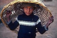 Boy playing with basket in Hadigau.