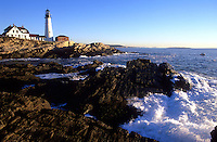 USA, Maine, Cape Elizabeth, Portland Head Lighthouse, early morning light  on light house with wave crashing on shoreline